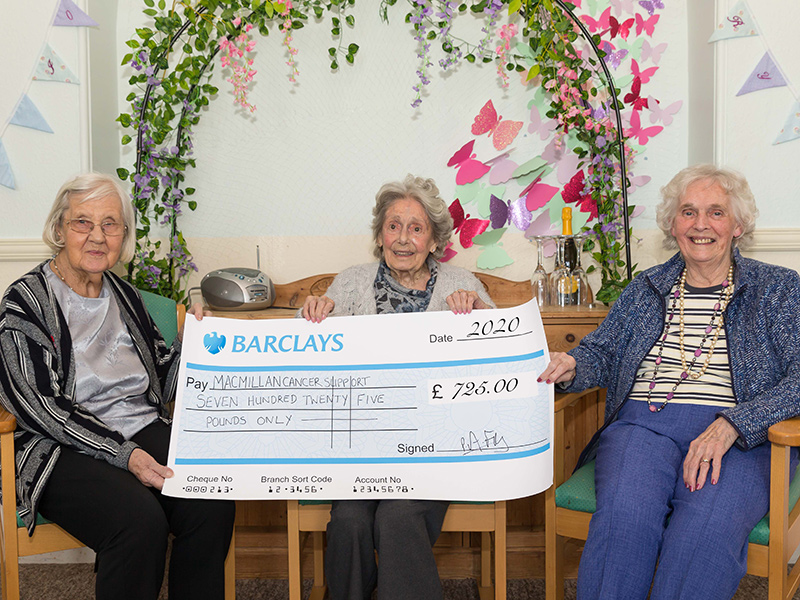 Friary Care hands over a cheque to Macmillan for £750